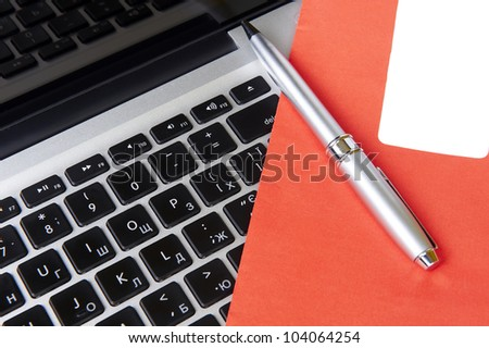 modern laptop and post envelope with pen - stock photo