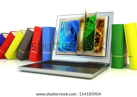 Modern laptop between books. The computer as an electronic repository of information contained in a huge number of books. - stock photo