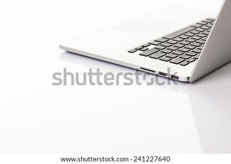 Modern laptop computer on white - stock photo