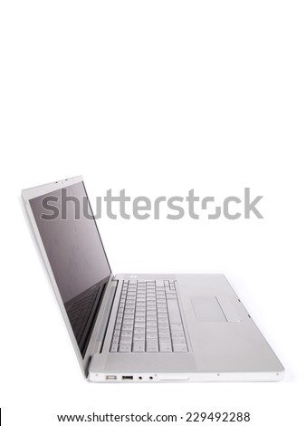 Modern laptop from the side shot in studio over a white background - stock photo