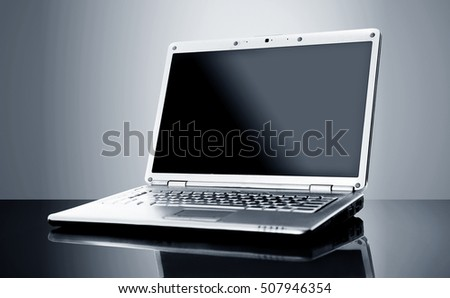 Modern laptop isolated on black background