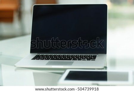 Modern laptop on table in office