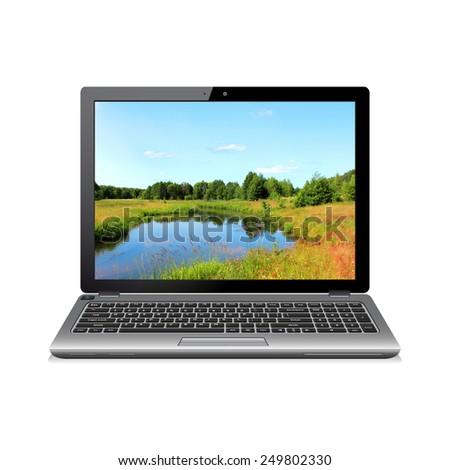 Modern laptop with landscape wallpaper - stock photo