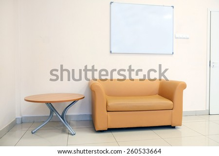 Modern leather sofa and table - stock photo