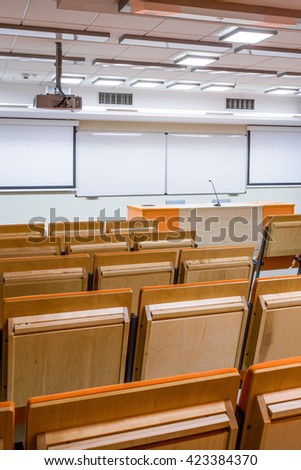 Modern lecture hall seen from the back row