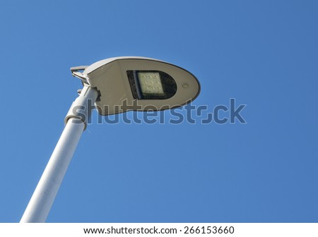 modern LED street lamp post against a blue sky - stock photo