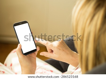modern lifestyle concept: mature woman with 3d generated touchscreen smartphone with empty screen - stock photo