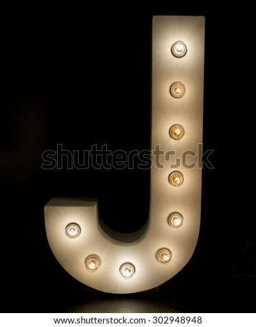 "modern lighting ""J"" alphabet isolated on black background - stock photo"
