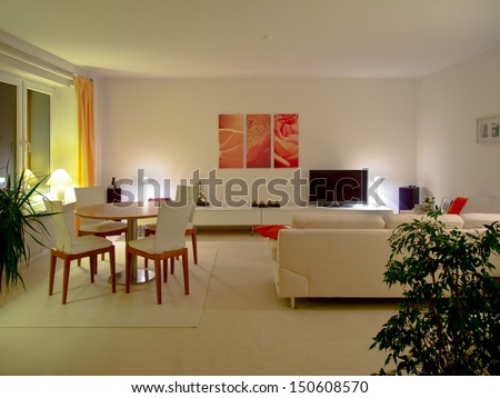 modern living and dining room by night - stock photo