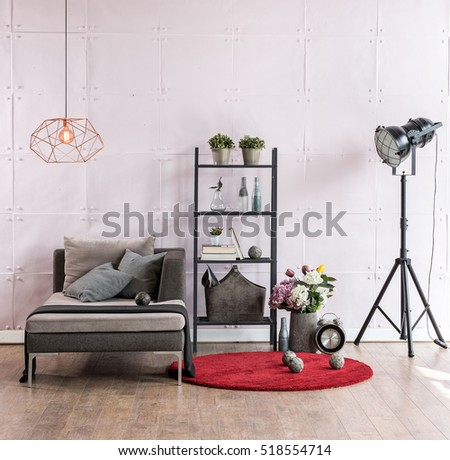 modern living room corner sofa behind stone soft wall and black lamp with red carpet, modern lamp
