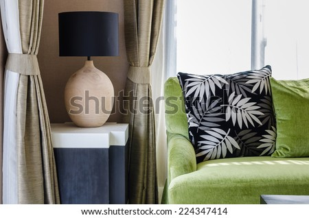 modern living room design with green sofa - stock photo