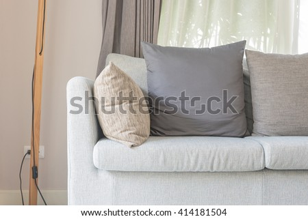 modern living room design with grey sofa and pillows