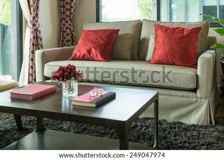 modern living room design with red pillows on sofa - stock photo
