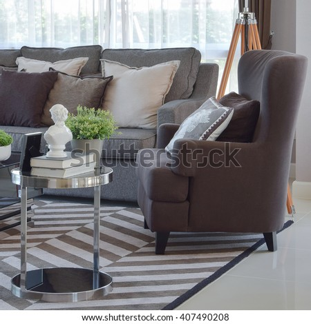 modern living room design with tweed brown sofa and armchair - stock photo