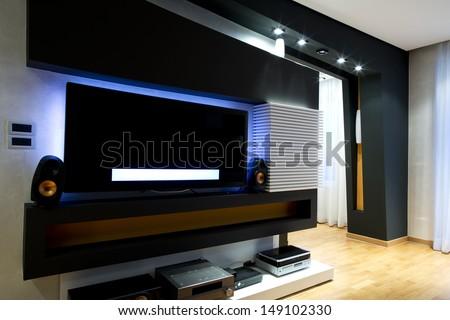 Modern living room home cinema - stock photo