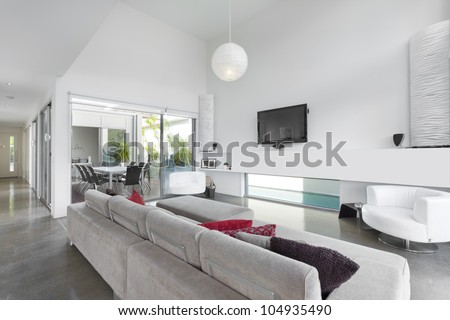 Modern living room in Australian mansion - stock photo