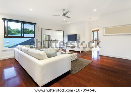 Modern living room in stylish mansion - stock photo