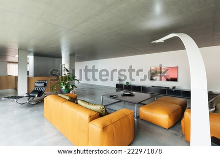 Modern living room, interior house, concrete walls   - stock photo
