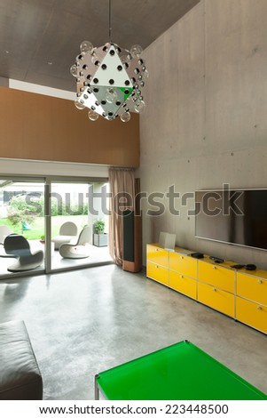 Modern living room, interior house, veranda view - stock photo