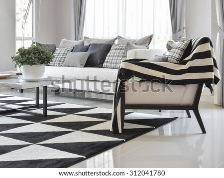 Modern Living Room Interior With Black And White Checked Pattern Pillows Carpet