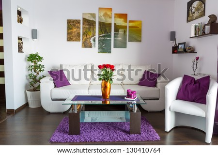 Modern living room interior with canvas on the wall. Photos on canvas are available in my gallery. - stock photo