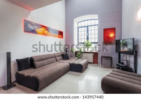 Modern living room interior with comfortable grey sofa - stock photo