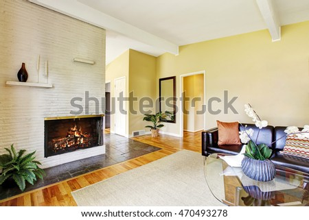 Modern living room interior with fireplace and glass coffee table. Northwest, USA