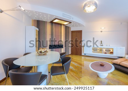 Modern living room interior with marble floor in luxury apartment, Krakow city, Poland
