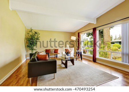 Modern living room interior with two windows and glass coffee table. Northwest, USA