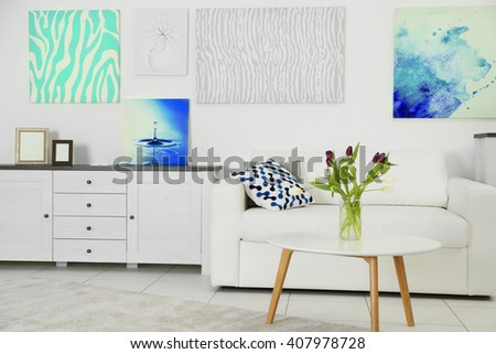 Modern living room interior with white sofa and coffee table on a white background - stock photo