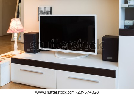 Modern living room - TV and speakers - ambient light, enhanced colors - stock photo