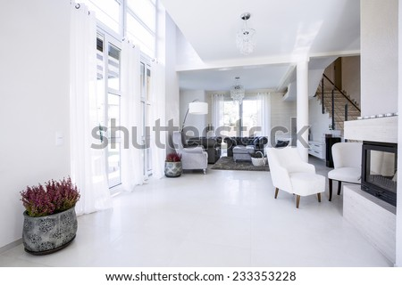 Modern living room with big garden windows - stock photo
