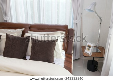 modern living room with brown pillows and lamp - stock photo