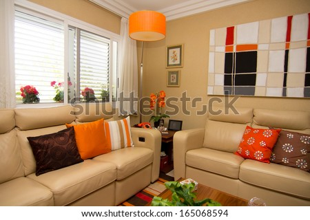 modern living room with colors combined in all items - stock photo