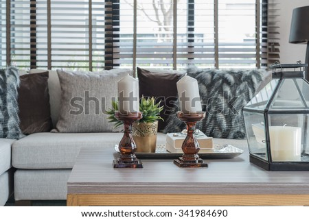modern living room with decorate ornament on wooden table  - blur background effect - stock photo