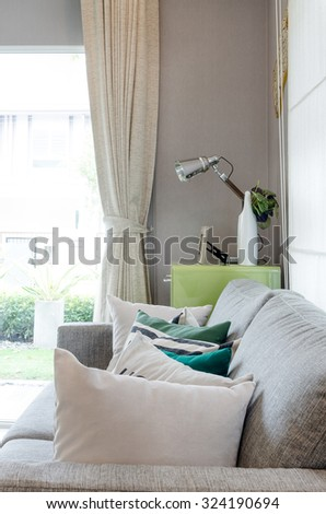 modern living room with sofa and green table side with lamp