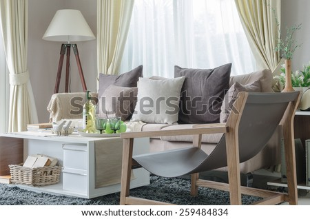 modern living room with sofa and white lamp at home - stock photo