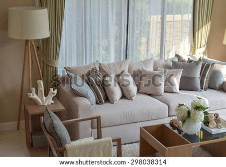 modern living room with sofa and wooden lamp at home - stock photo