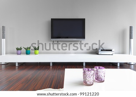 Modern living-room with TV and hifi equipment - stock photo