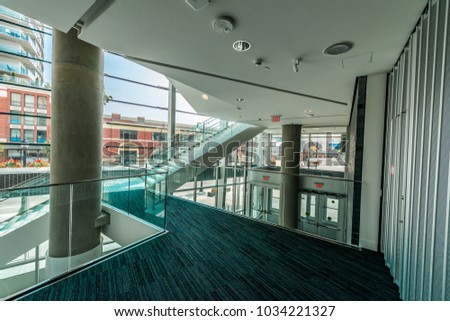 Modern lobby, hallway, plaza, hotel, shopping mall, business center in Vancouver, Canada. Interior design. Vertical.