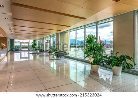 Modern lobby, hallway, plaza of the five stars luxury hotel, shopping mall, business center in Vancouver, Canada. Interior design. Vertical. - stock photo
