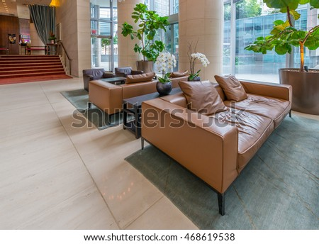 Modern lobby, hallway, plaza of the luxury hotel, shopping mall, business center.  Interior design.