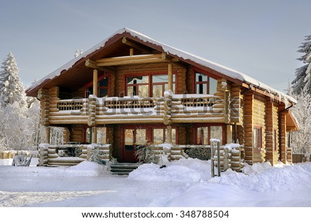 Modern log cabin, wooden vacation home, winter timber house with large windows, balcony and porch, snow-covered spruce forest. - stock photo