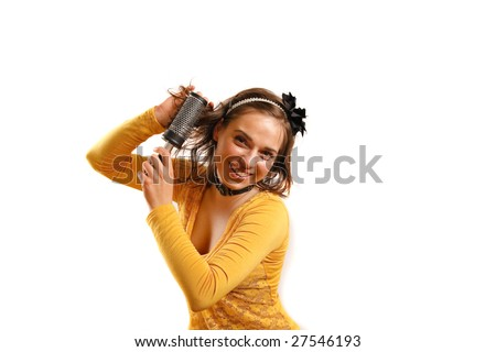 Modern looking young woman looking at the camera - stock photo