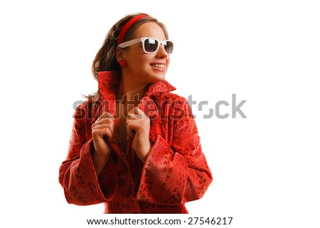 Modern looking young woman wearing a red jacket and sunglasses - stock photo