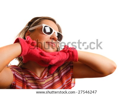 Modern looking young woman wearing sun glasses - stock photo