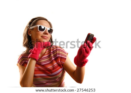 Modern looking young woman wearing sun glasses, looking at the phone - stock photo