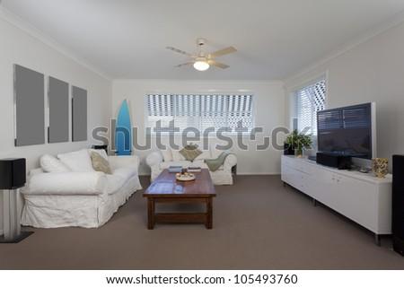Modern lounge room in Australian mansion - stock photo
