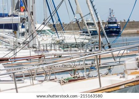 Modern Luxurious Yachts In Port Close Up - stock photo