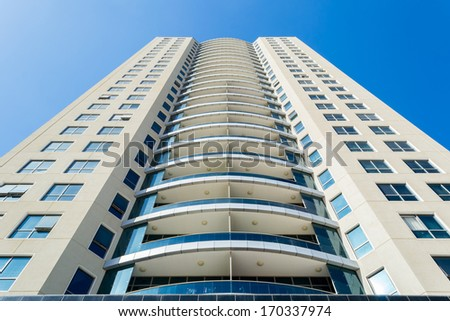 Modern Luxury Apartment against Blue Sky  - stock photo